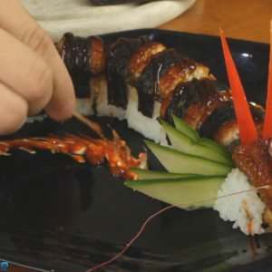 Dragon-Sushi-Roll-plate-garnish-made-by-sushi-chef