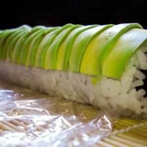 sushi-rolling-with-avocado-on-top