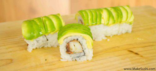 avocado covered sushi roll